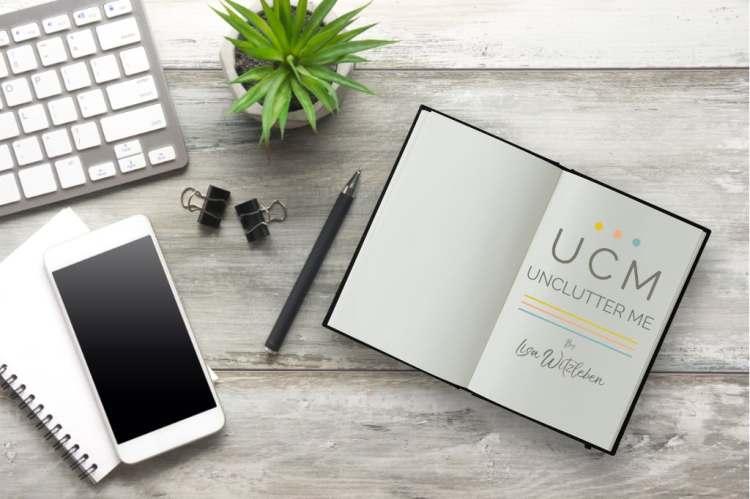 Unclutter Me workbook, tips sheet on desk beside keyboard and pen